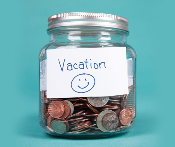 Jar labeled vacation filled with money.