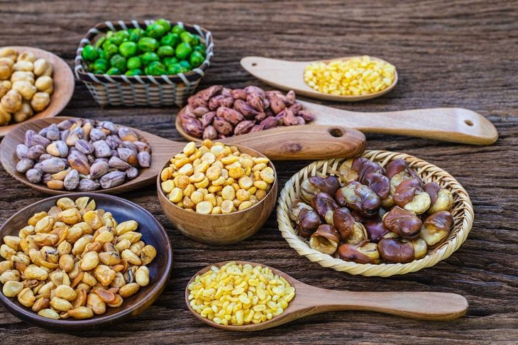 The beans seed on wooden background,.